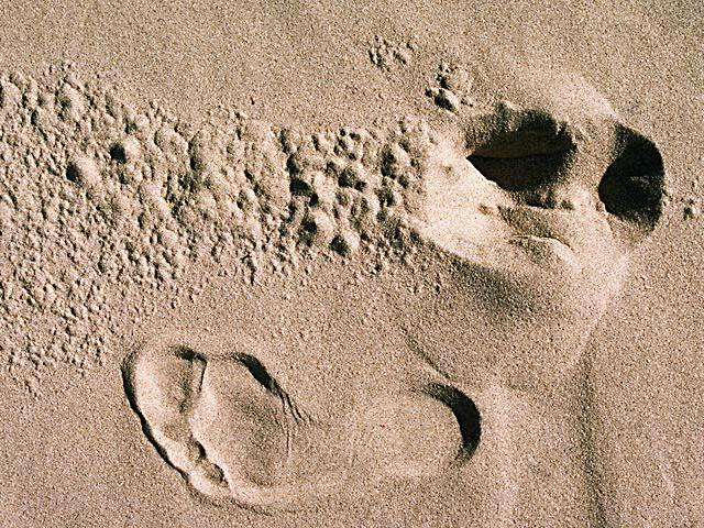 Footprints in sand wallpaper