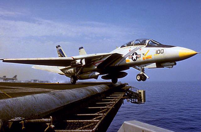 F-14 Taking off from<br />an aircraft carrier wallpaper